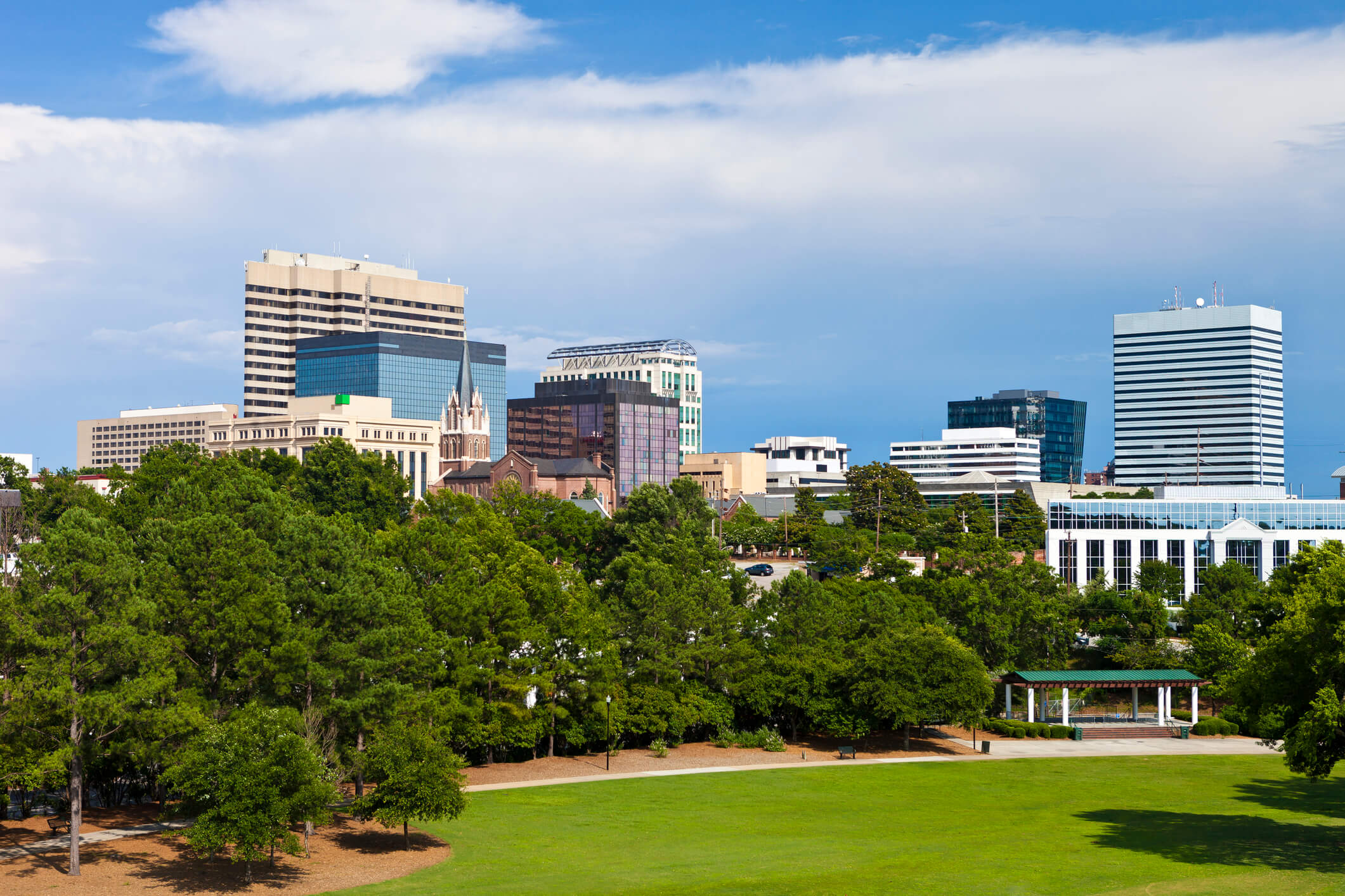 Photo of the Columbia South Carolina skyline showing all the buildings and skyrises on a nice summer day