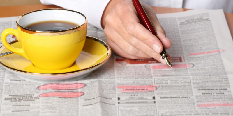 this is a photo of a person drinking coffee looking for job, and title loans can help them