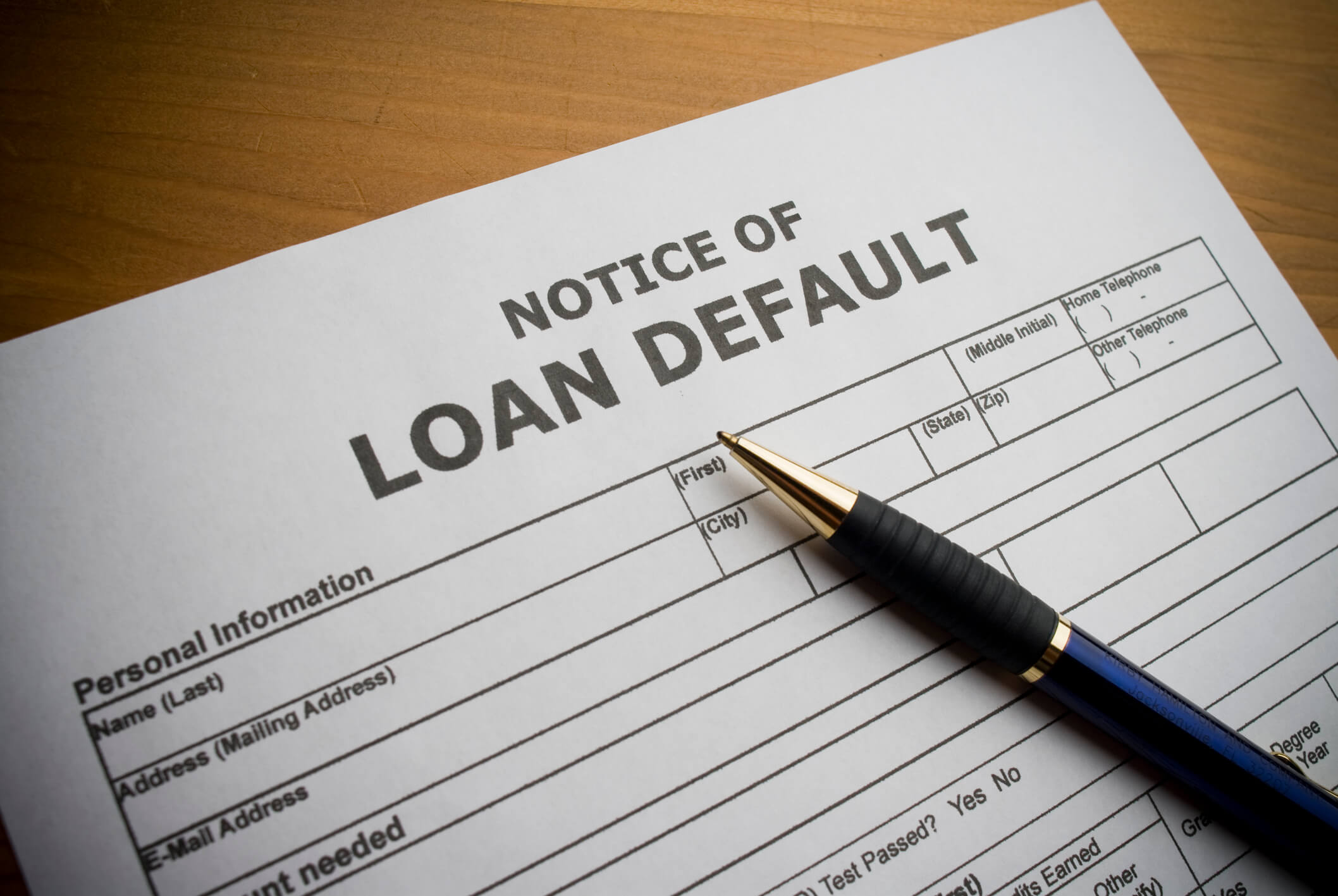 This is a photo of a paper form for filing title loan default