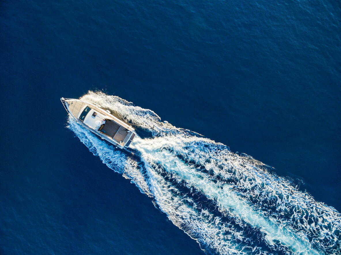 this is an aerial shot of a boat moving through the water