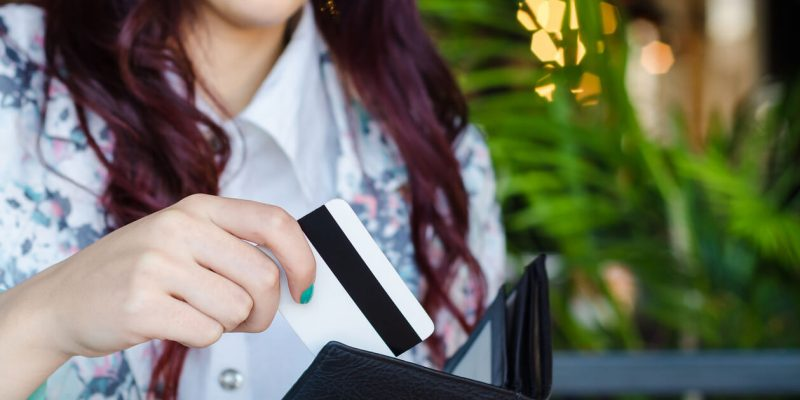 this is a photo of a woman paying here restaurant bill with her card