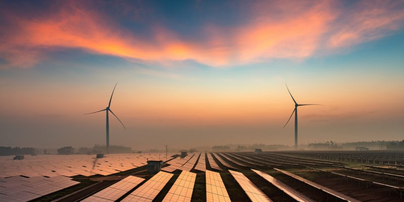 This is a photo of a solar and wind farm in the fields